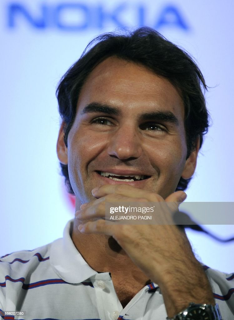 Swiss tennis player Roger Federer gestures during a press conference with Argentinian Juan Martin Del Potro (not in picture), in Tigre, near Buenos Aires, on December 11, 2012, ahead of two exhibition matches that will be held on 12 and 13 December. AFP PHOTO / Alejandro PAGNI