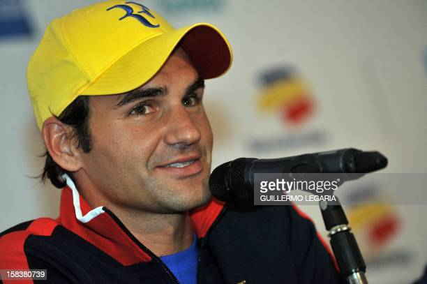 Swiss tennis player Roger Federer gestures during a press conference in Bogota Colombia on December 14 ahead of an exhibition match that he will play...