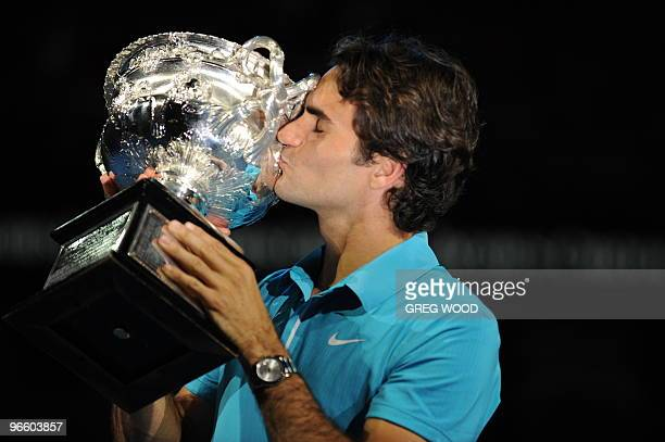 Swiss tennis player Roger Federer kisses the trophy after victory in his men's singles final match against British opponent Andy Murray at the...