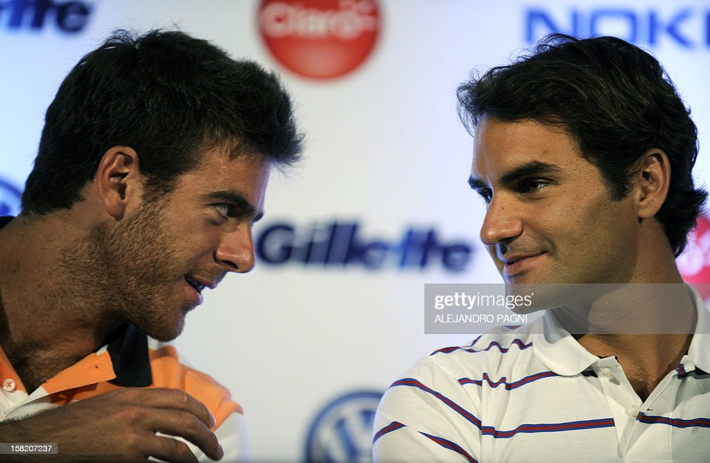 Swiss tennis player Roger Federer (R) listens to Argentinian Juan Martin Del Potro, during a press conference in Tigre, near Buenos Aires on December 11, 2012, ahead two exhibition matches that will be held on December 12 and 13. AFP PHOTO / Alejandro PAGNI