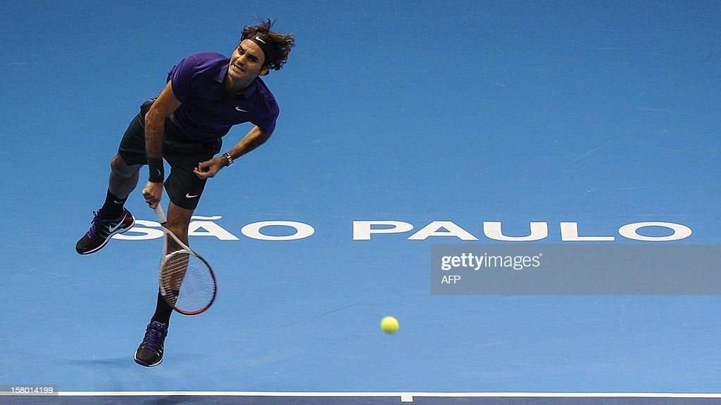 Swiss tennis player Roger Federer makes a serve against French Jo-Wilfried Tsonga during an exhibition match held at the Ibirapuera Gymnasium in Sao Paulo, Brazil, on December 8, 2012. AFP PHOTO/Yasuyoshi CHIBA