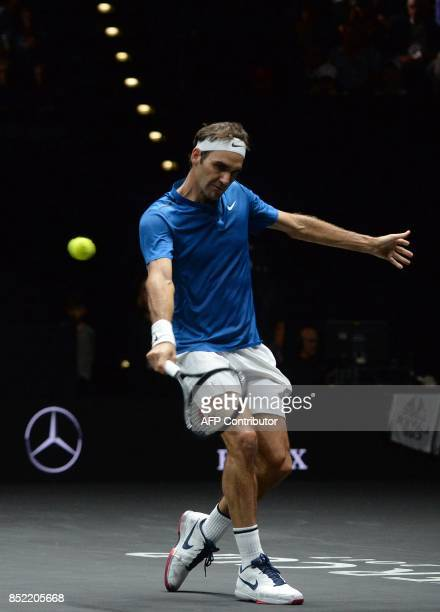 Swiss tennis player Roger Federer of Team Europe returns a ball to Sam Querrey of the United States and Team World during the second day of the Laver...