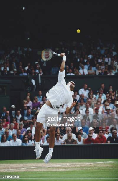 Swiss tennis player Roger Federer pictured in action against Mark Philippoussis in the final of the Men's Singles tournament at the Wimbledon Lawn...