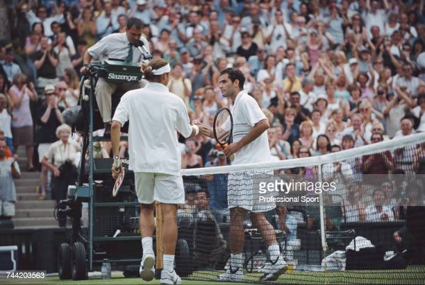 Swiss tennis player Roger Federer pictured shaking hands with American tennis player Pete Sampras after winning the match 76 57 64 67 75 in the...