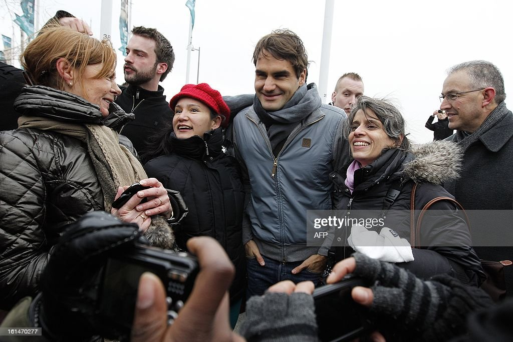 Swiss tennis player Roger Federer (C) poses with fans on February 11, 2013 during the opening of the Rotterdam World Tennis in Rotterdam, which ends on February 17. CZERWINSKI - netherlands out -