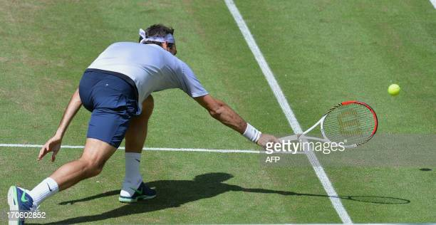 Swiss tennis player Roger Federer returns a ball during the semifinal match against German Tommy Haas at the ATP Gerry Weber Open tennis tournament...