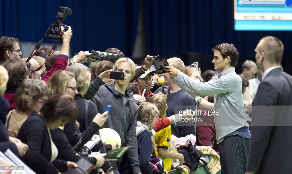 Swiss tennis player Roger Federer signs autographs after a training session on the first day of the ABN AMRO World Tennis Tournament in Rotterdam on February 11, 2013. The tournament is taking place until February 17.