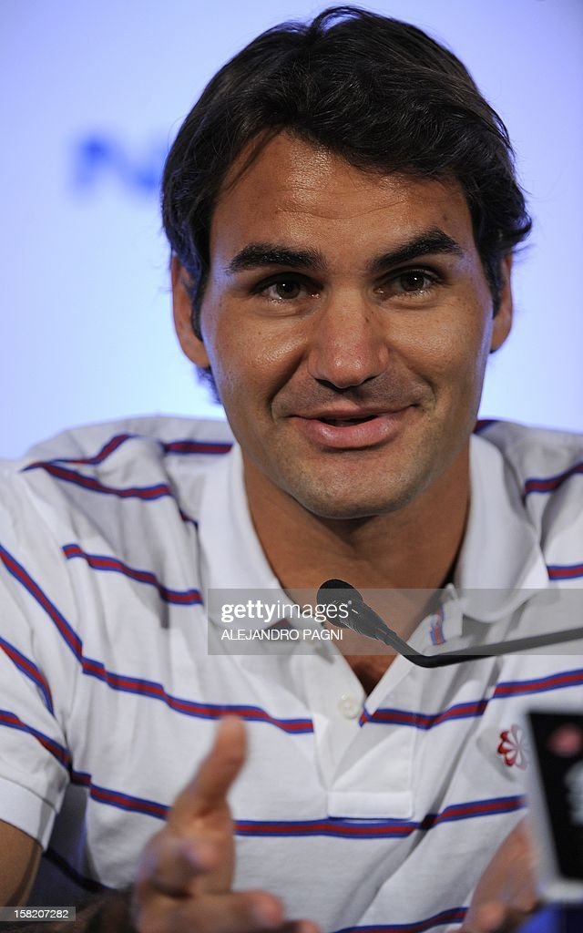 Swiss tennis player Roger Federer speaks during a press conference with Argentinian Juan Martin Del Potro (not in picture), in Tigre, near Buenos Aires, on December 11, 2012, ahead of two exhibition matches that will be held on 12 and 13 December. AFP PHOTO / Alejandro PAGNI