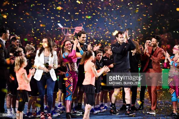 Swiss tennis superstar Roger Federer and world number one Britain's Andy Murray celebrate at the end of a charity match 'The Match for Africa 3' on...