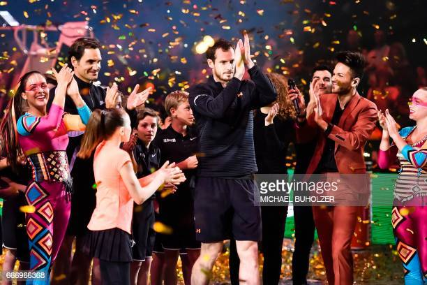 TOPSHOT Swiss tennis superstar Roger Federer and world number one Britain's Andy Murray celebrate at the end of a charity match 'The Match for Africa...