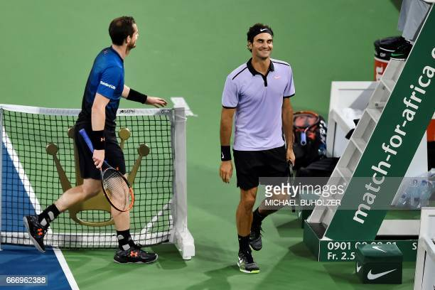 Swiss tennis superstar Roger Federer jokes with world number one Britain's Andy Murray during a charity match 'The Match for Africa 3' on April 10...