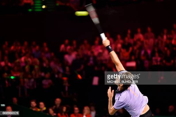 Swiss tennis superstar Roger Federer serves the ball to Britain's Andy Murray during a charity match 'The Match for Africa 3' on April 10 2017 in...