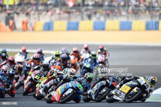 Swiss Thomas Luthi on his Kalex Garage Plus Interwetten N° 12 leads the race at the fisrt corner ahead of Italy's rider Francesco Bagnaia on his Sky...