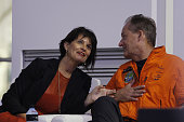 Swiss Vice President Doris Leuthard listens to pilot Andre Borschberg during a press conference after the Solar Impulse 2 aircraft landed at Al Batin...