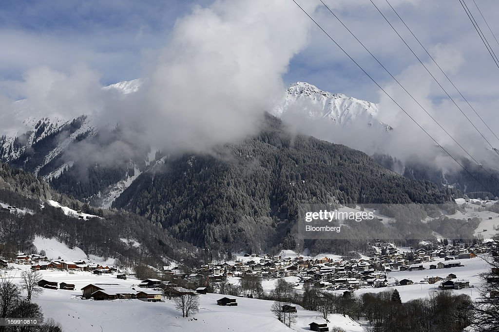 A Swiss village is seen covered in snow in this aerial photograph taken from a helicopter near Davos, Switzerland, on Tuesday, Jan. 22, 2013. World leaders, Influential executives, bankers and policy makers arrive in the Swiss Alps for the 43rd annual meeting of the World Economic Forum in Davos, the five day event runs from Jan. 23-27. Photographer: Simon Dawson/Bloomberg via Getty Images