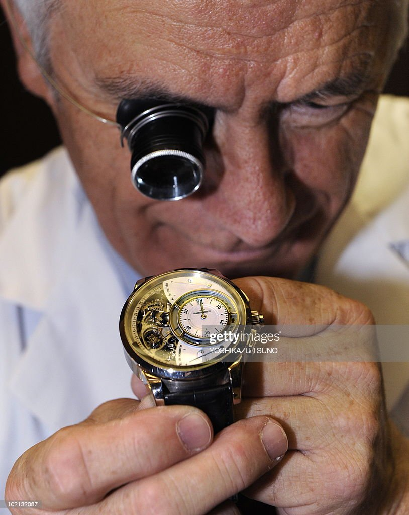 Swiss watch maker Jager-LeCoultre craftmaster Joel Cordier displays the company's new masterpiece wrist-watch Grand Sonnerie as the company started to sell a set of three masterpiece wrist-watches 'Hybris Mechanica 55', composed with Triptyque, Grands Sonnerie and Gyrotourbillon in Tokyo on June 16, 2010. Mitsukoshi store started to sell the set of white-gold made mechanical watches from June 16 with a price of 3 million USD as one of 30 sets of the world limited model. AFP PHOTO / Yoshikazu TSUNO