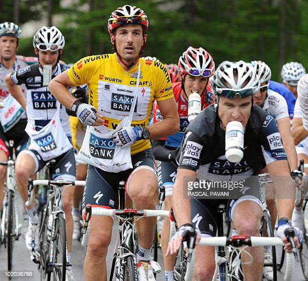 Swiss yellow jersey leader Fabian Cancellara Australain Stuart O'Grady Luxembourg Andy Schleck and Franck Schleck ride during the second stage Ascona...