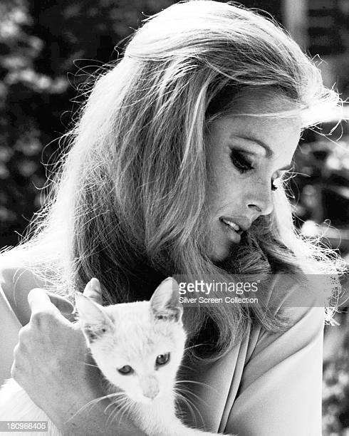 SwissAmerican actress Ursula Andress holding a cat circa 1968