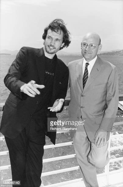 Swissborn French actor Vincent Perez with American producer Edward R Pressman at the Hotel Du Cap in Antibes France shortly after the Cannes Film...