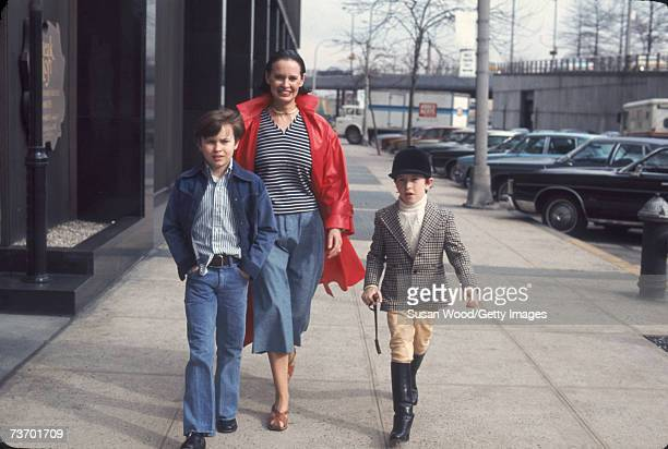 Swissborn socialite Gloria Vanderbilt and her two sons Carter Vanderbilt Cooper and Anderson Cooper walk along a sidewalk in New York New York March...