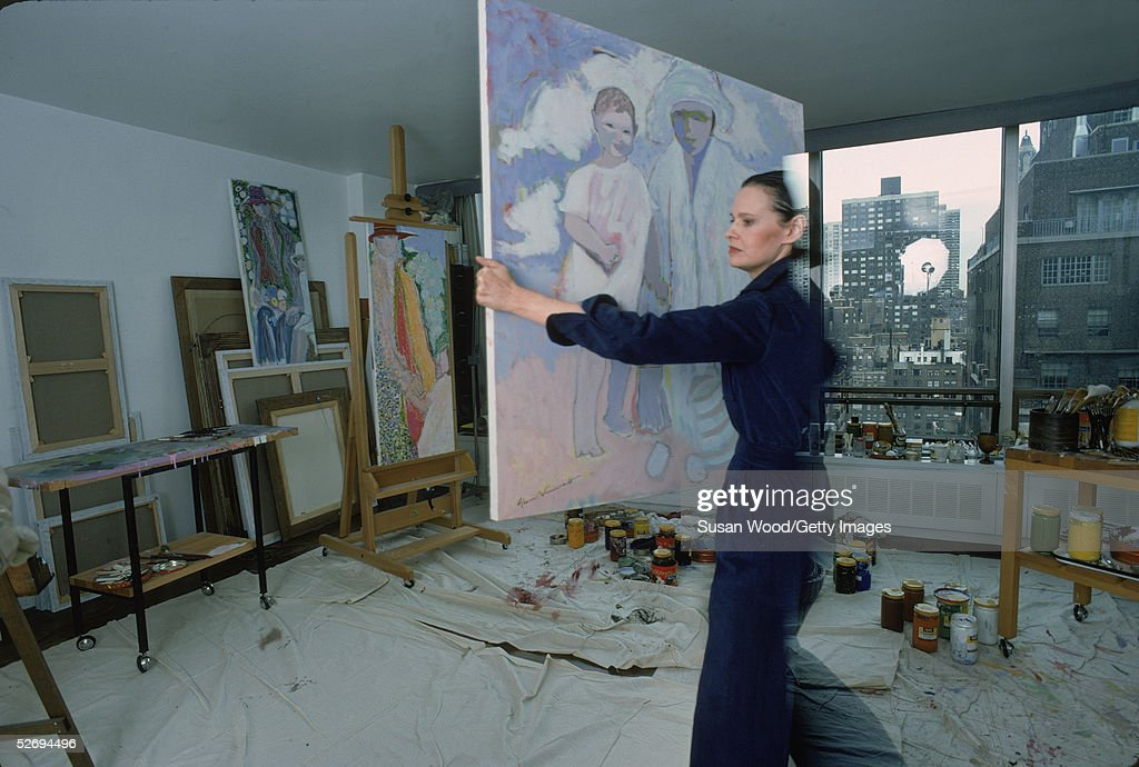 Swiss-born socialite <a gi-track='captionPersonalityLinkClicked' href=/galleries/search?phrase=Gloria+Vanderbilt+-+Fashion+Designer&family=editorial&specificpeople=214786 ng-click='$event.stopPropagation()'>Gloria Vanderbilt</a> carries a painting in her studio at her home in the UN Towers, New York, New York, March 1976.