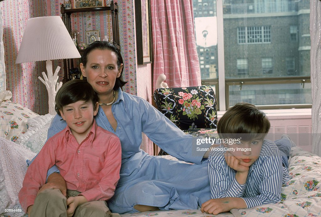Swiss-born socialite <a gi-track='captionPersonalityLinkClicked' href=/galleries/search?phrase=Gloria+Vanderbilt+-+Fashion+Designer&family=editorial&specificpeople=214786 ng-click='$event.stopPropagation()'>Gloria Vanderbilt</a> poses with her two sons <a gi-track='captionPersonalityLinkClicked' href=/galleries/search?phrase=Anderson+Cooper&family=editorial&specificpeople=226776 ng-click='$event.stopPropagation()'>Anderson Cooper</a> and <a gi-track='captionPersonalityLinkClicked' href=/galleries/search?phrase=Carter+Vanderbilt+Cooper&family=editorial&specificpeople=2011921 ng-click='$event.stopPropagation()'>Carter Vanderbilt Cooper</a> (1965 - 1988) on her bed in their apartment in the UN Towers, New York, New York, March 1976.
