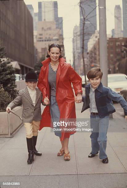Swissborn socialite Gloria Vanderbilt runs down a street with her two sons Anderson Cooper and Carter Vanderbilt Cooper New York New York March 1976