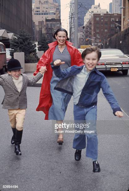 Swissborn socialite Gloria Vanderbilt runs down the street with her two sons Anderson Cooper and Carter Vanderbilt Cooper New York New York