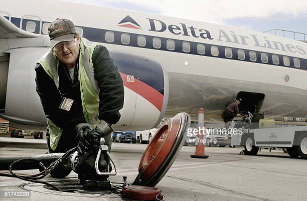 Swissport Fueling employee Daniel Berg disconnects the main fuel line after refueling this Delta AirLines jet at Phoenix Sky Harbor International...