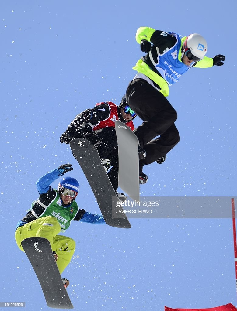 Swisssnowboarder Tim Watter, Canadian snowboarder Robert Fagan and Spanish snowboarder Lucas Eguibar compete during theMen's Snowboard Cross final race at the Snowboard and FreeStyle World Cup Super finals at Sierra Nevada ski resort near Granada on March 21, 2013.