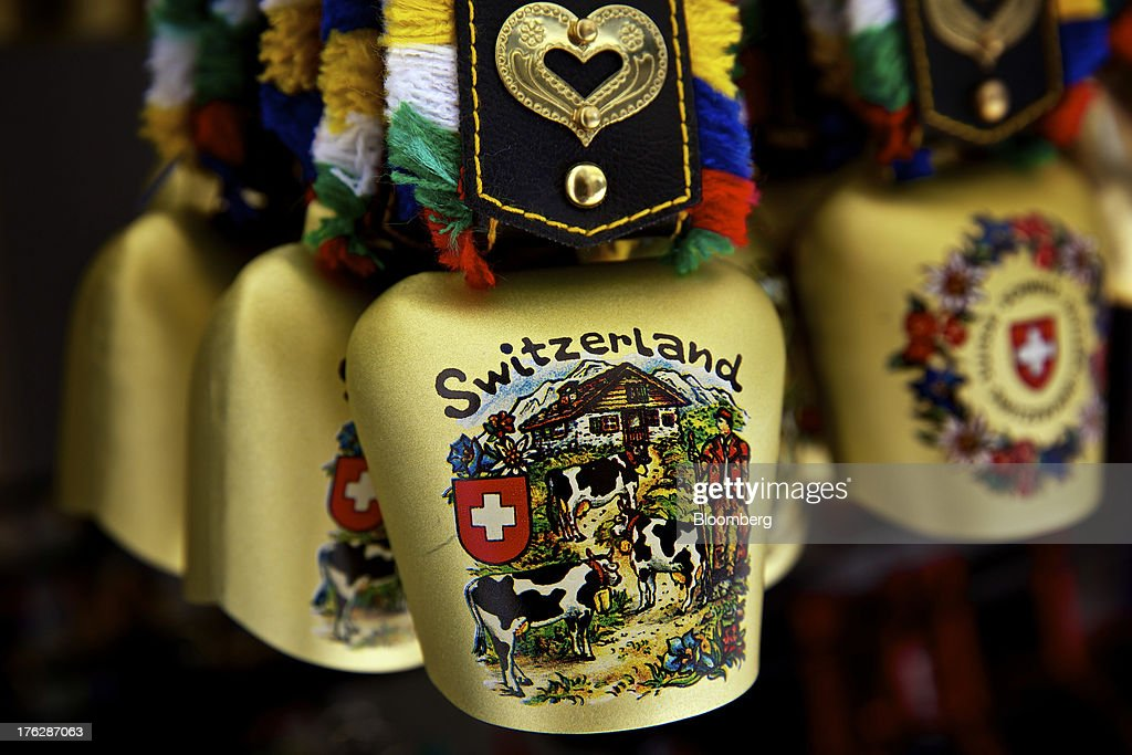 Swiss-themed cow bells are displayed for sale inside a souvenir store in Lucerne, Switzerland, on Saturday, Aug. 10, 2013. The Swiss National Bank will abolish its franc ceiling once it starts raising interest rates, Vice President Jean-Pierre Danthine said. Photographer: Gianluca Colla/Bloomberg via Getty Images
