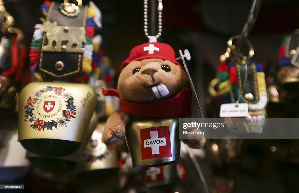 Swiss-themed souvenirs hang on display in a tourist store in Davos, Switzerland, on Friday, Jan. 18, 2013. Next week the business elite gather in the Swiss Alps for the 43rd annual meeting of the World Economic Forum in Davos, the five day event runs from Jan. 23-27. Photographer: Chris Ratcliffe/Bloomberg via Getty Images