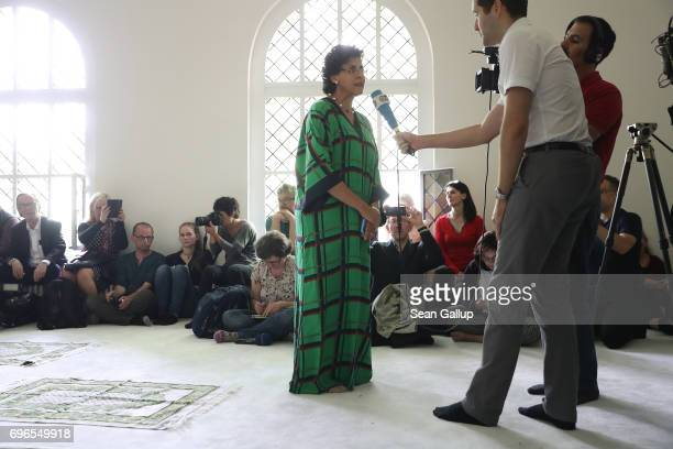 SwissYemeni politicalscientist Elham Manea speaks to the media before she participated in leading Friday prayers during the opening of the...