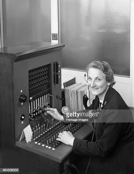 Switch board operator Spillers Animal Foods Gainsborough Lincolnshire 1960 A late 1950s style plug in telephone switch board
