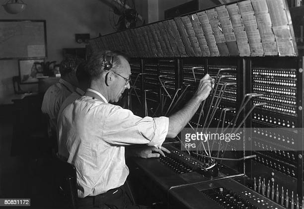 Switchboard operators handling nonemergency calls to the police circa 1950