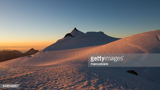 Switzerland, Allalinhorn, The Alps, Wallis, View of snowcapped mountains at sunrise
