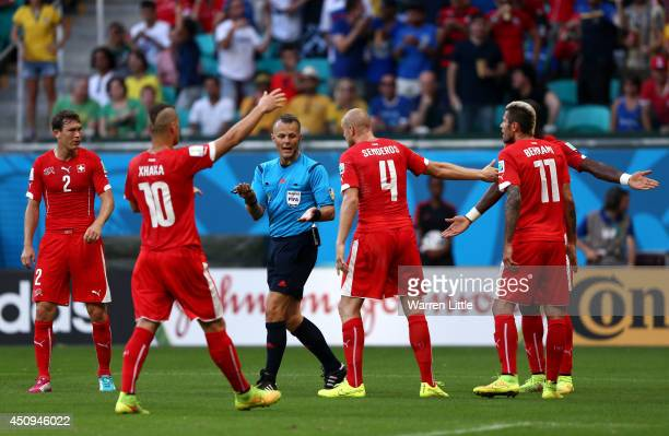 Switzerland appeal to referee Bjorn Kuipers after awarding a penalty kick during the 2014 FIFA World Cup Brazil Group E match between Switzerland and...
