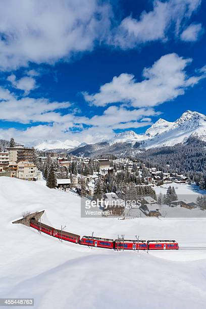 Switzerland, Arosa, Rhaetian railway passing through snow