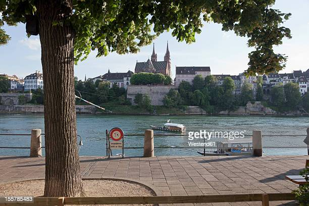 Switzerland, Basel, View of Basel Munster across Rhine River