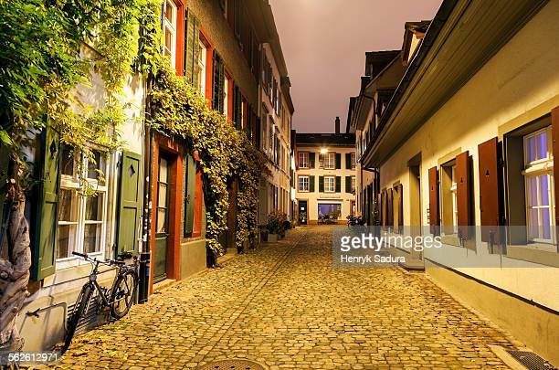Switzerland, Basel-Stadt, Basel, View along illuminated old town street