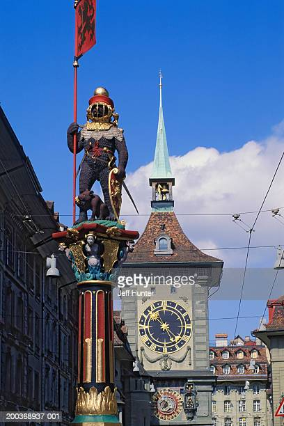 Switzerland, Berne, clock tower and statue at Zahringer Fountain