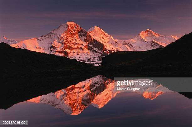 Switzerland, Bernese Alps, Eiger, Monch and Jungfrau reflected in lake
