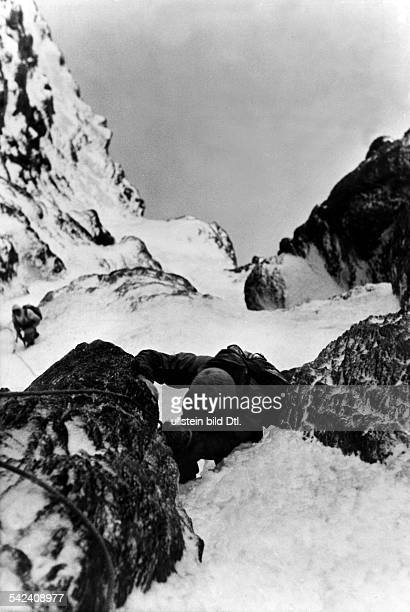 Switzerland Bernese Alps EigerFirst ascent of Eiger north face 2124July 1938 Picture taken from above to second member of the roped party who climbs...