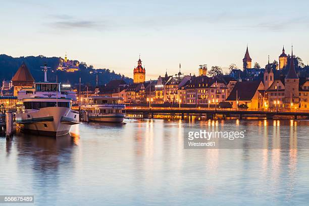Switzerland, Canton of Lucerne, Lucerne, Lake Lucerne, Excursion ships at pier in the evening