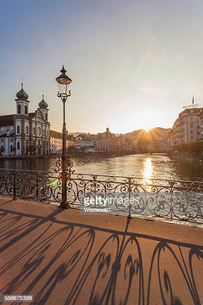 Switzerland, Canton of Lucerne, Lucerne, Old town, Reuss river, Jesuit church at sunset