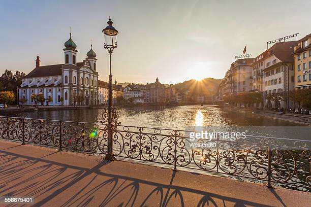 Switzerland, Canton of Lucerne, Lucerne, Old town, Reuss river, Jesuit church at sunset