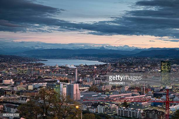 Switzerland, Canton Zurich, Zurich, city view to Zuerichsee and Swiss Alps in the evening