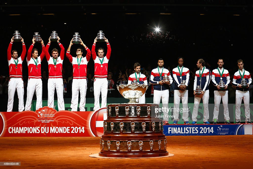 Switzerland celebrate winning the Davis Cup against France during day three of the Davis Cup Tennis Final between France and Switzerland at the Stade...
