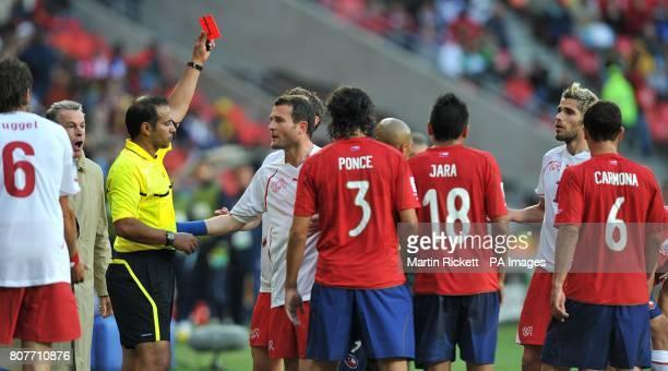 Switzerland coach Ottmar Hitzfeld shouts as referee Khalil Al Ghamdi shows Valon Behrami the red card