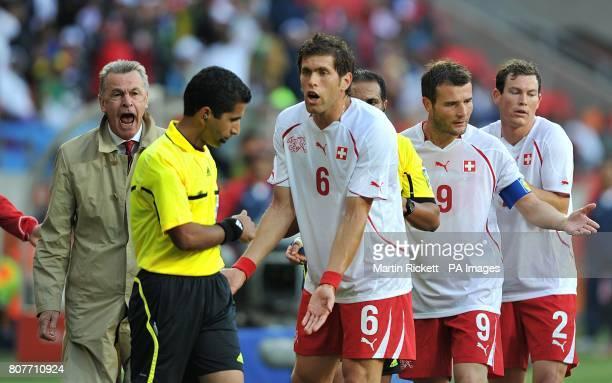 Switzerland coach Ottmar Hitzfeld shouts at referee Khalil Al Ghamdi after sending off Valon Behrami